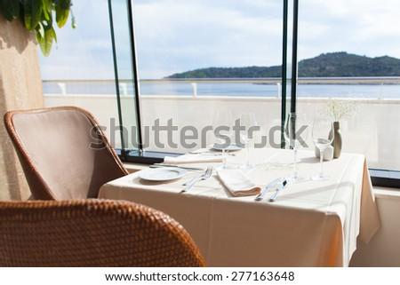 empty restaurant interior with sea view - stock photo