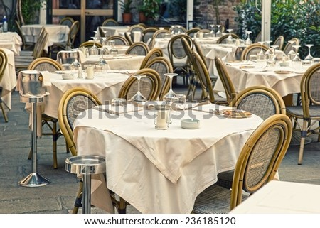 Empty restaurant tables in the Italian city of Venice - stock photo
