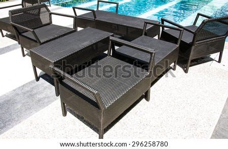 empty resting chair near swimming pool - stock photo