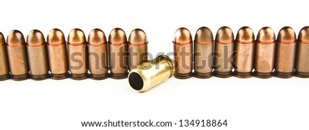 Empty revolving sleeves on a white background.  Spent cartridges are left out of the whole number of bullets   idea of ??exception, the plans, failure, unusual - stock photo