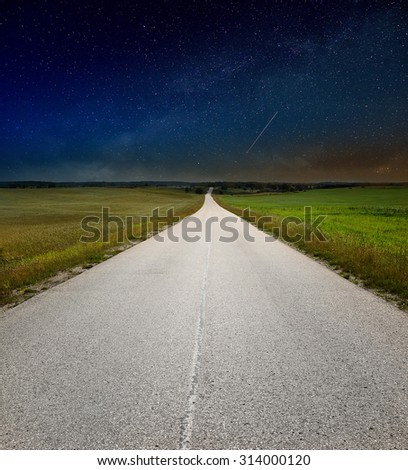 Empty road and night sky - stock photo