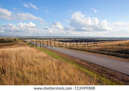 empty road at sunset - stock photo