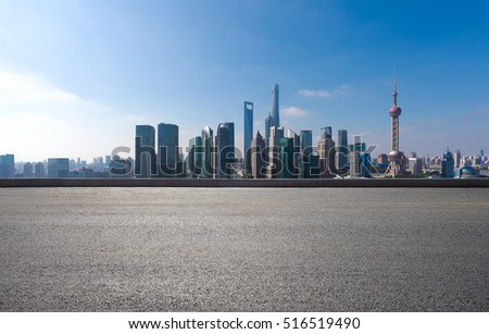 Empty road floor surface with modern city landmark buildings in Shanghai skyline of panorama
