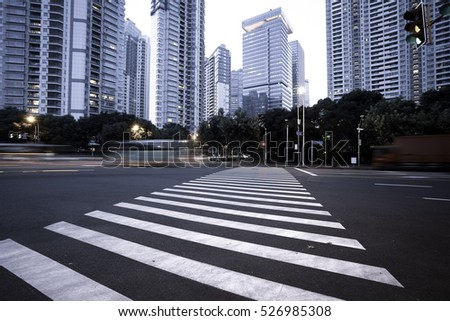 Empty road floor surface with modern city landmark buildings of evening in Shanghai
