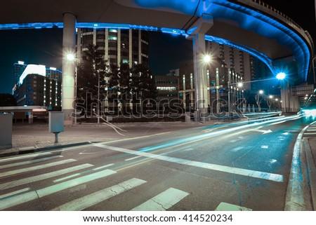 Empty road floor with city elevated bridge of night scene - stock photo