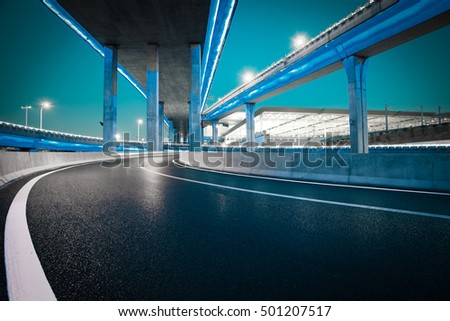 Empty road floor with city elevated bridge of night scene