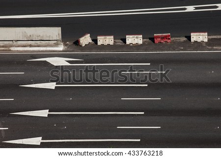 Empty road from top view, arrows and street block signs at Sao Paulo, Brazil.