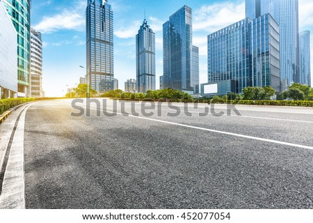 empty road front of modern buildings - stock photo