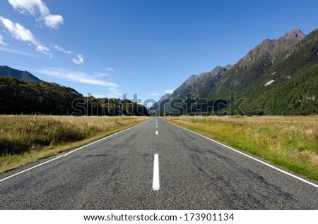 Empty road in Fiordland, New Zealand - stock photo