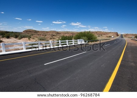 Empty road in Namibia - stock photo