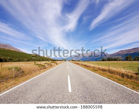 Empty road in scenic view of New Zealand - stock photo