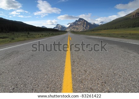 Empty road leading to the mountains