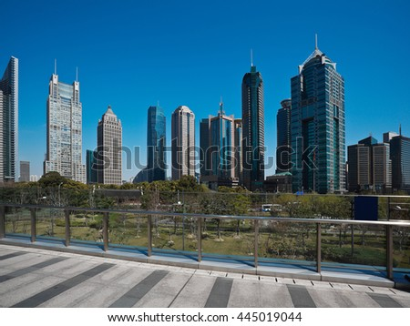 Empty road marble floor of footbridge with city landmark office buildings backgrounds in shanghai China