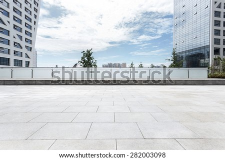 Empty road nearby office building - stock photo