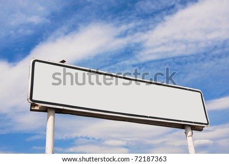 Empty road sign against a background of blue sky with clouds