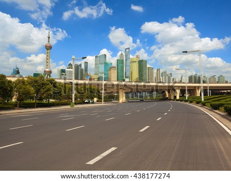 Empty road surface with shanghai bund lujiazui modern city buildings backgrounds  - stock photo