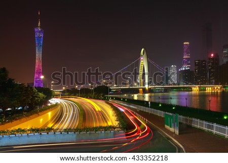 Empty road textured floor at car light trail with  landmark architecture backgrounds of night scene in guangzhou China