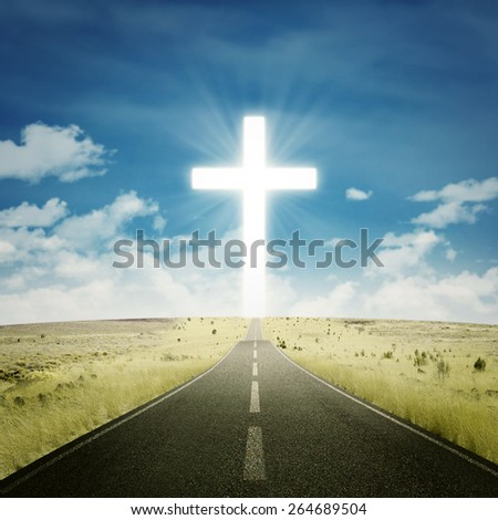Empty road toward the heaven with a cross on the end of the road - stock photo