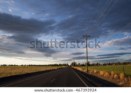 empty road under a dark and stormy sky