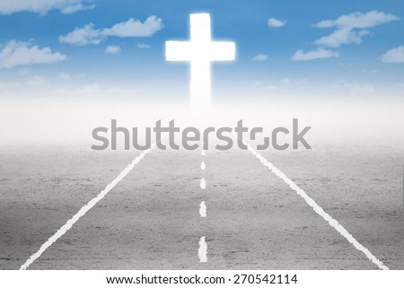 Empty road with a cross on the end of the road - stock photo