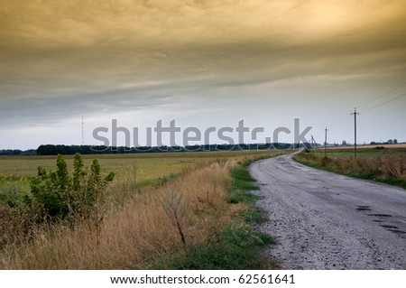 Empty road with thunderclouds on background - stock photo