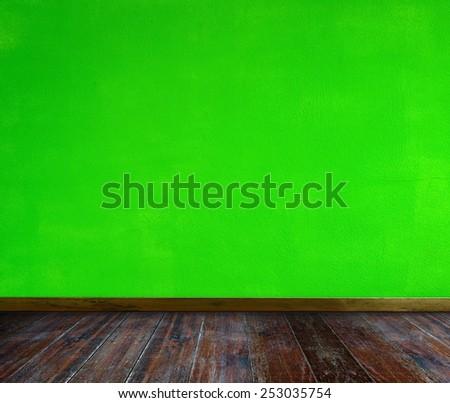 Empty room. Green wall and wood floor. - stock photo