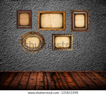 Empty room interior with black wall and vintage photo frames - stock photo