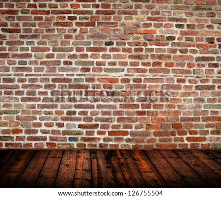 Empty room interior with brickwall and wooden floor - stock photo