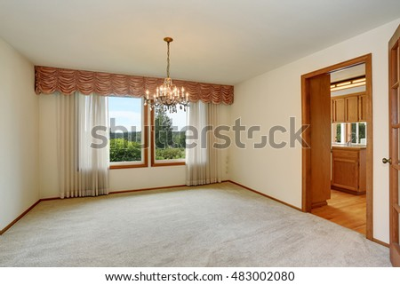 Empty room interior with carpet floor and nice chandelier. Northwest, USA