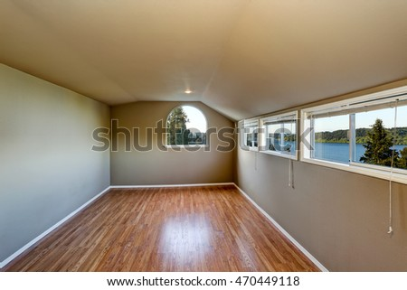 Empty room interior with green walls and carpet floor. Perfect water view through windows. Northwest, USA