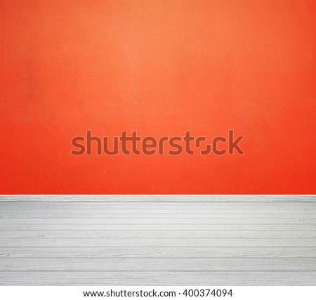 empty room interior with orange concrete wall and white wood floor