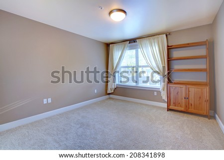 Empty room interior with soft carpet and cabinet in corner - stock photo
