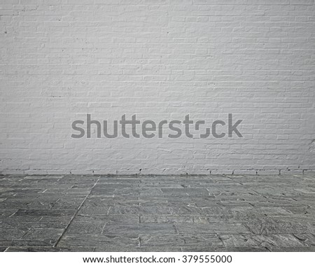 Empty room interior with whit brick wall and stone floor