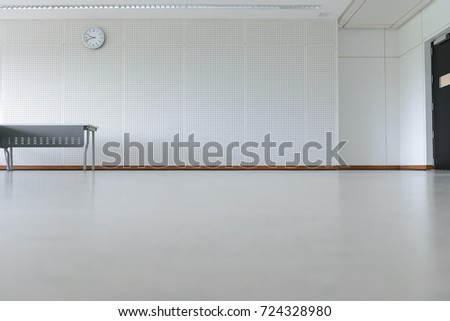 Empty Room Modern Interior   Floor With Soundproof Wall, Door, Clock And  Table