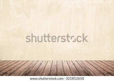 Empty room of old grunge beige concrete wall and dark brown wooden floor, use for interior background or backdrop - stock photo