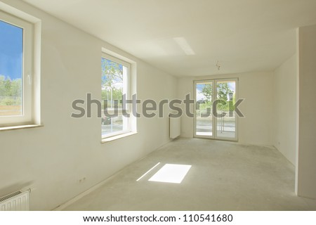 Empty room under construction in a new constructed building - stock photo