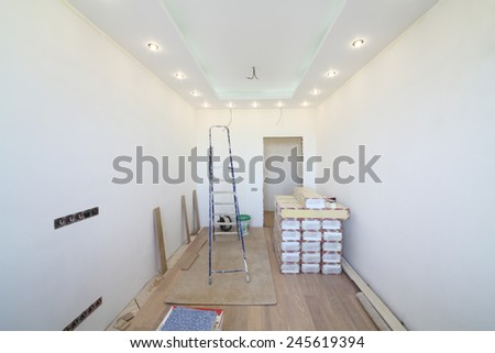 Empty room where there is a repair with tool and building material - stock photo