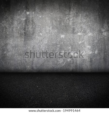 Empty Room With asphalt Floor and concrete Wall grunge Interior