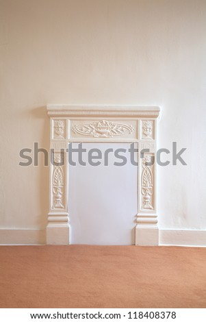 Empty room with blocked up fireplace - stock photo