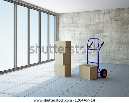 Empty room with boxes and pushcart near the window - stock photo
