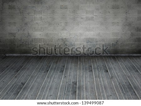 Empty room with brick wall and worn wooden boards