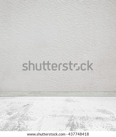 Empty room with concrete wall and stone floor