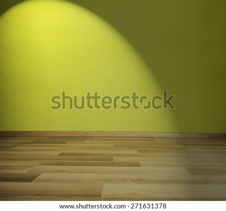 Empty room with green wall, wooden floor and spot light - stock photo