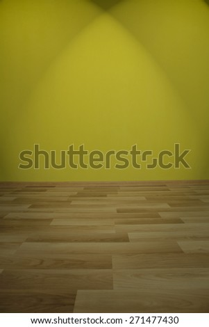 Empty room with green wall, wooden floor and spot lights - stock photo