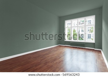 empty room with green walls and wooden floor