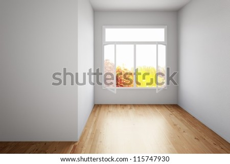 Empty room with hardwood floor and open window - stock photo