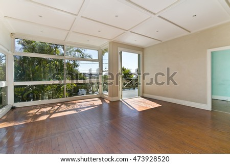 Empty room, with huge windows and a gorgeous view.