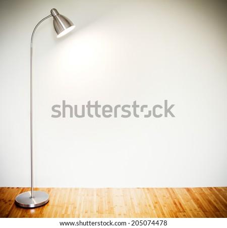 Empty room with modern floor lamp  - stock photo