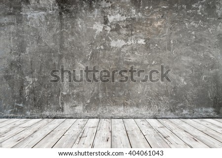 empty room with old vintage cement wall and wooden floor