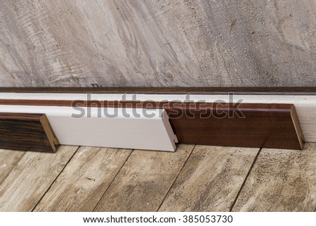 Empty room with old wood floor and rough plaster walls. Photo skirting close up.   - stock photo